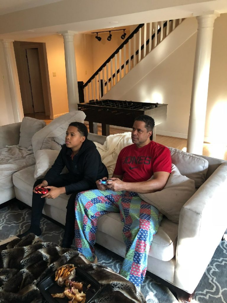 Dr. Booker and son Quint on the PlayStation.
