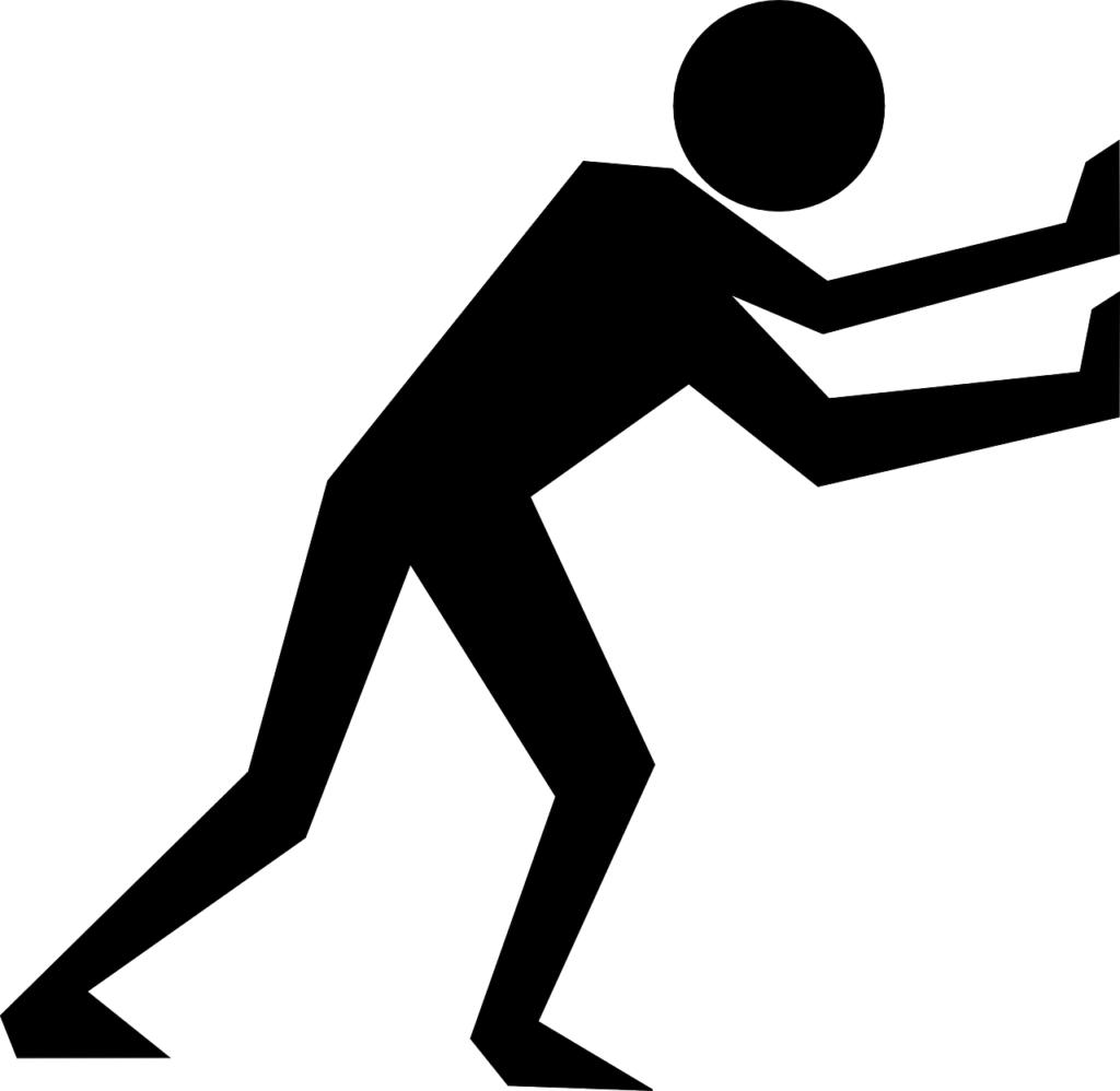 Silhouette of man pushing