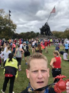 Dr. Hatch selfie showing off his MCM Medal at the Iwo Jima Memorial